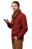 Junger Mann mit einem Mobiltelefon Lizenzfreie Stockbilder