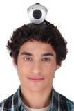 Junger Mann mit einem Netznocken Stockfotos