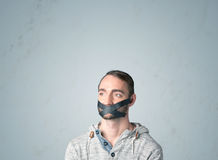 Junger Mann mit geklebtem Mund Lizenzfreies Stockfoto