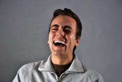 Junger Mann mit glücklichem Ausdruck Stockbilder