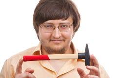 Junger Mann mit Hammer Stockbild