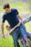 Junger Mann mit Kind Stockfotografie