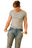 Junger Mann mit leeren Taschen Lizenzfreies Stockbild