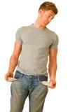 Junger Mann mit leeren Taschen Stockfotografie