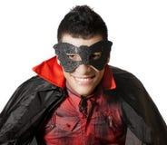 Junger Mann mit Maske und Kap Stockfotografie