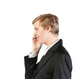 Junger Mann mit Mobiltelefon Stockfoto