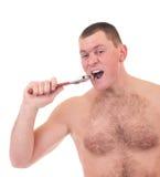 Junger Mann mit muskulöser Karosserie lizenzfreies stockfoto