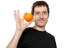 Junger Mann mit Orange Stockbild