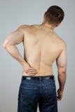 Junger Mann mit Rückenschmerzen Lizenzfreies Stockbild