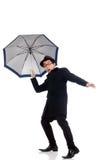 Junger Mann mit Regenschirm Stockbild
