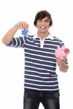 Junger Mann mit Taste und piggybank. Lizenzfreie Stockbilder