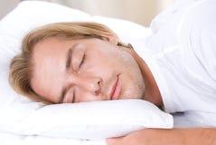 Junger Mann-Schlafen Stockbilder