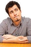 Junger Mann in seinem mid-20s mit durchdachtem expressio Stockfotos