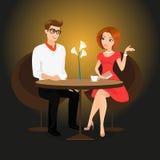 Junger Mann und Frau haben ein Datum im Restaurant Stockfoto