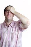 Junger Mann und Kopfschmerzen Stockbild