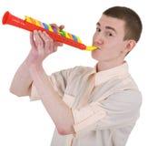 Junger Mann und Spielzeug, Trompete Stockbilder