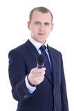 Junger männlicher Journalist mit dem Mikrofon, das Interview lokalisiert nimmt Lizenzfreie Stockfotografie