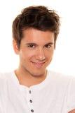 Junger, netter Mann, freundliches Lächeln. Portrait lizenzfreie stockbilder