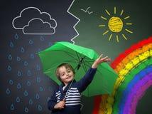 Junger Optimist eine Änderung im Wetter Stockbild