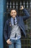Junger schwarzer Mann mit Zaun des bearbeiteten Eisens Lizenzfreie Stockfotos