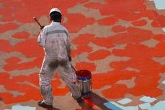 Junger Seaman Painting His Ship Lizenzfreie Stockbilder
