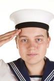 Junger Seemann, der getrennten weißen Hintergrund begrüßt Lizenzfreies Stockbild