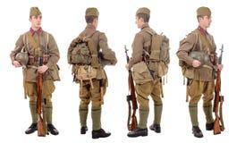 Junger sowjetischer Soldat mit SVT-Gewehr, Front, Profil, hinter Stockfotografie