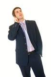 Junger stattlicher Geschäftsmann mit Mobiltelefon dem Benennen stockbilder