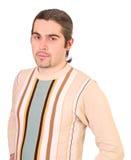 Junger stattlicher Mann in der Strickjacke getrennt Lizenzfreies Stockfoto