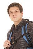 Junger Student mit dem Rucksack, der weg vom Denken anstarrt Lizenzfreie Stockbilder