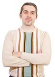 Junger triumphierender stattlicher Mann in der Strickjacke trennte Stockfoto