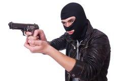 Junger Verbrecher mit Gewehr Stockfoto