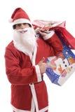 Junger Weihnachtsmann, voll von den Geschenken Stockbild