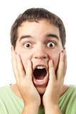 Junges überraschtes Mannportrait getrennt auf Weiß Lizenzfreies Stockbild