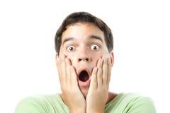 Junges überraschtes Mannportrait getrennt auf Weiß Stockfotografie