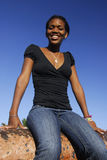 Junges Afroamerikanermädchen auf Canon Stockbild