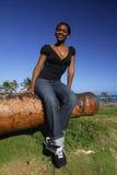 Junges Afroamerikanermädchen auf Canon Lizenzfreies Stockbild