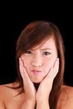 Junges asiatisches amerikanisches jugendlich Mädchen, das ein Gesicht bildet Lizenzfreie Stockbilder