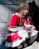 Junges asiatisches Mädchen mit dem cosplay Schauen Lizenzfreies Stockfoto