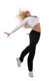 Junges blondes Frauen-Springen Lizenzfreie Stockfotografie