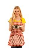 Junges blondes Frauenkochen lokalisiert über weißem Hintergrund Stockbild