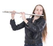 Junges blondes jugendlich Mädchen mit Flöte im Studio gegen weißen Hintergrund Stockfoto