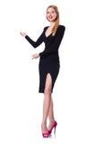 Junges blondes Mädchen in der schwarzen Kleidervertretung lokalisiert Lizenzfreie Stockfotos