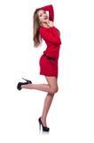 Junges blondes Mädchen im roten kurzen Kleid an lokalisiert Lizenzfreie Stockfotos