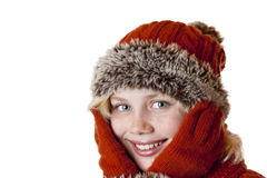 Junges blondes Mädchen mit Winterschutzkappe und -handschuhen. Stockbilder