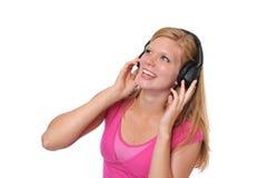 Junges blondes mit Kopfhörern Lizenzfreie Stockfotos