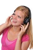 Junges blondes mit Kopfhörern Lizenzfreie Stockfotografie