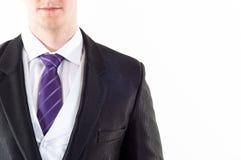 Junges buisnessman mit purpurroter Gleichheit Lizenzfreie Stockbilder
