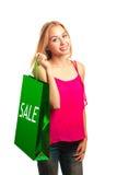 Junges erwachsenes Mädchen des Porträts mit grüner Tasche Lizenzfreie Stockfotos
