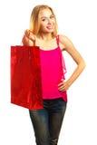 Junges erwachsenes Mädchen des Porträts mit roter Tasche Lizenzfreie Stockbilder